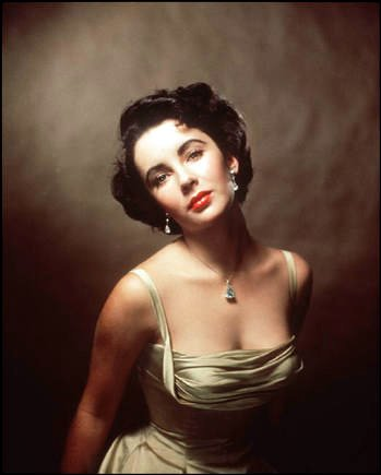 Elizabeth Taylor by Philippe Halsman   diff shot of same pic with gold silk dress
